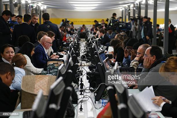 Journalists work in a media room at the COP 21 United Nations conference on climate change on November 30 2015 in Le Bourget on the outskirts of the...