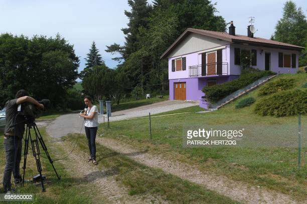 Journalists work in Aumontzey on June 14 in front of Marcel and Jacqueline Jacob's house on the day they were placed in custody over Gregory...