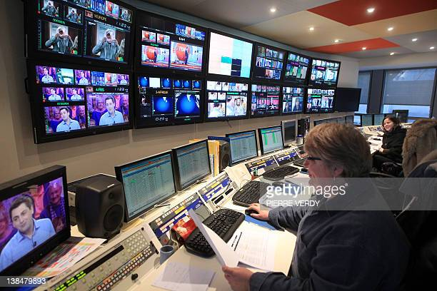Journalists work in front of screens in the central control room at French international station TV5 Monde headquarters on February 7 2012 in Paris...