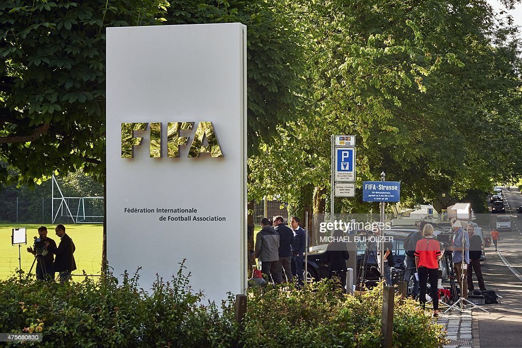 Journalists work in front of the FIFA headquarters on June 3, 2015 in ...