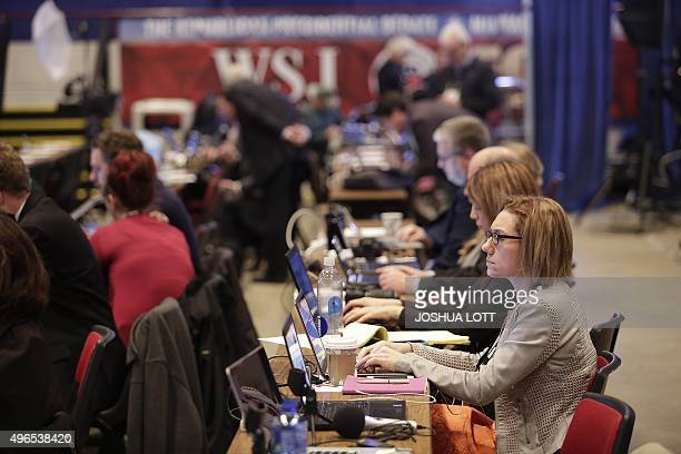 Journalists work in the filing center before the start of the Republican Presidential Debate hosted by Fox Business and The Wall Street Journal...