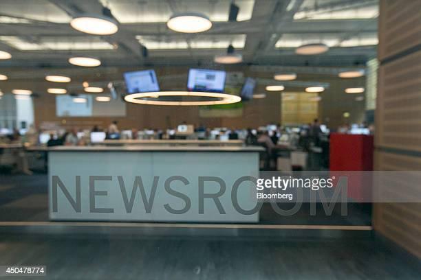 Journalists work inside the newsroom of broadsheet newspaper Die Welt published by Axel Springer SE in Berlin Germany on Wednesday June 11 2014 Axel...