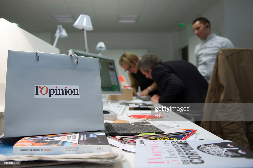 Journalists work inside the office of new French media company 'L'Opinion', which aims to be a daily online newspaper also sold in print form five days a week, as well as an online news app and a webtv, in Paris, on May 6, 2013. The launch of the new newspaper will be on May 14, according to the CEO.