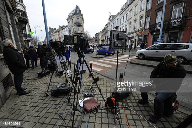 Journalists work near Colline street in Verviers eastern Belgium on January 16 after police shot dead two suspects in a gun battle after they opened...