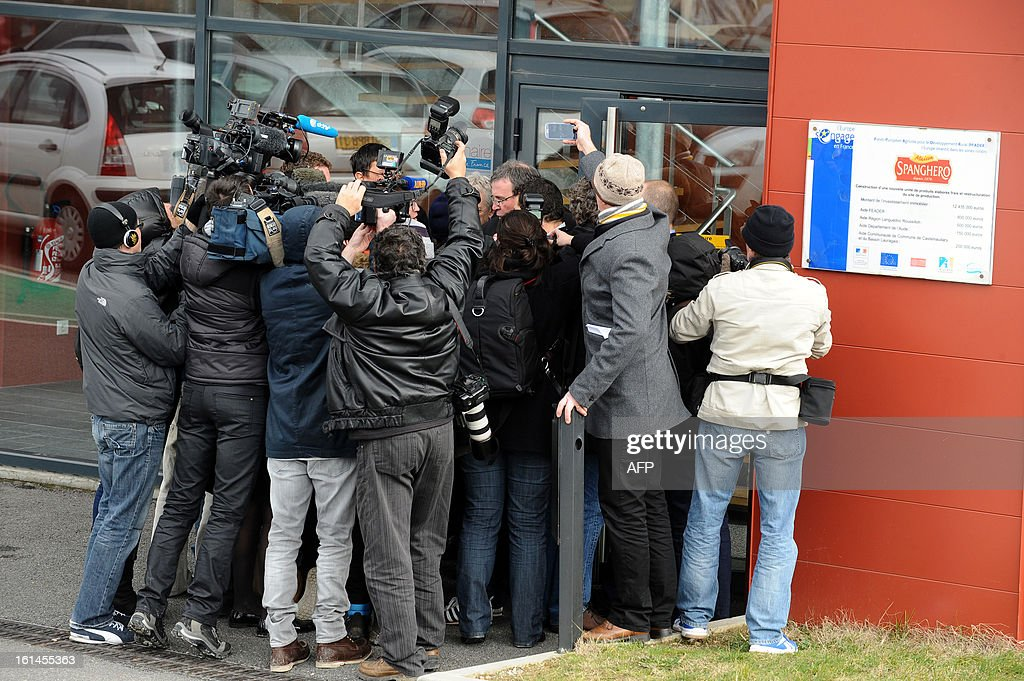 Journalits gather around French meat supplier Spanghero's president, Barthelemy Aguerre (C-Background), as he speaks to journalists on February 11, 2013 at the headquarters of Spanghero in Castelnaudary, southern France. The Europe-wide scandal over horsemeat sold as beef spread on February 10 as leading French retailers pulled products from their shelves and threats of legal action flew. The suspect lasagne meals sold by Swedish frozen food giant Findus in Britain were made by French company Comigel using meat supplied by French meat-processing firm Spanghero. Aguerre declared that Spanghero respected the law.
