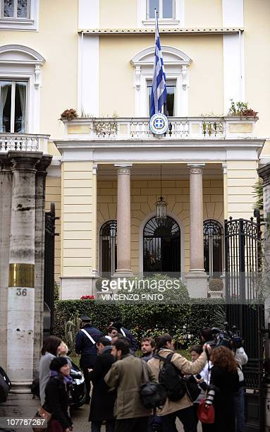 Journalits stand in front of the Greek embassy on December 27 2010 in Rome after a parcel bomb was found today just days after two similar packages...