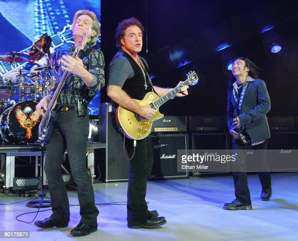 Journey bassist Ross Valory guitarist Neal Schon and singer Arnel Pineda perform at the Planet Hollywood Theatre for the Performing Arts March 8 2008...