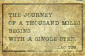 journey of a thousand miles - ancient Chinese philosopher Lao Tzu quote printed on grunge vintage cardboard..