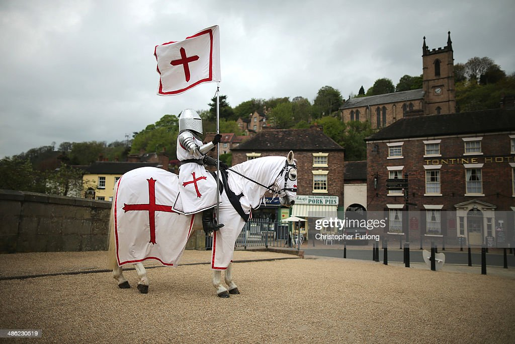 Jouster Justine Pearson, of The Knights of the Damned Jousting team, and her horse Des commemorate St George's Day standing on Thomas Telford's famous iron bridge on April 23, 2014 in Ironbridge, United Kingdom. Many people across England are celebrating England's patron saint on St George's Day.