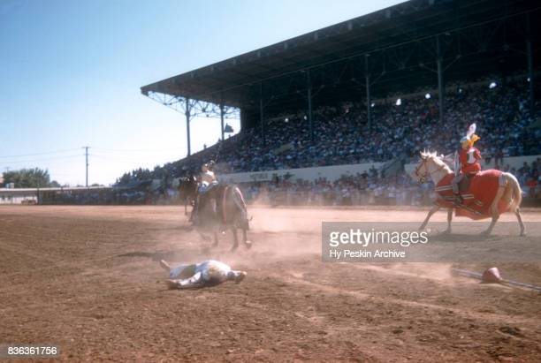 A jouster lays on the ground after losing the fight during the Sacramento State Fair circa August 1958 in Sacramento California