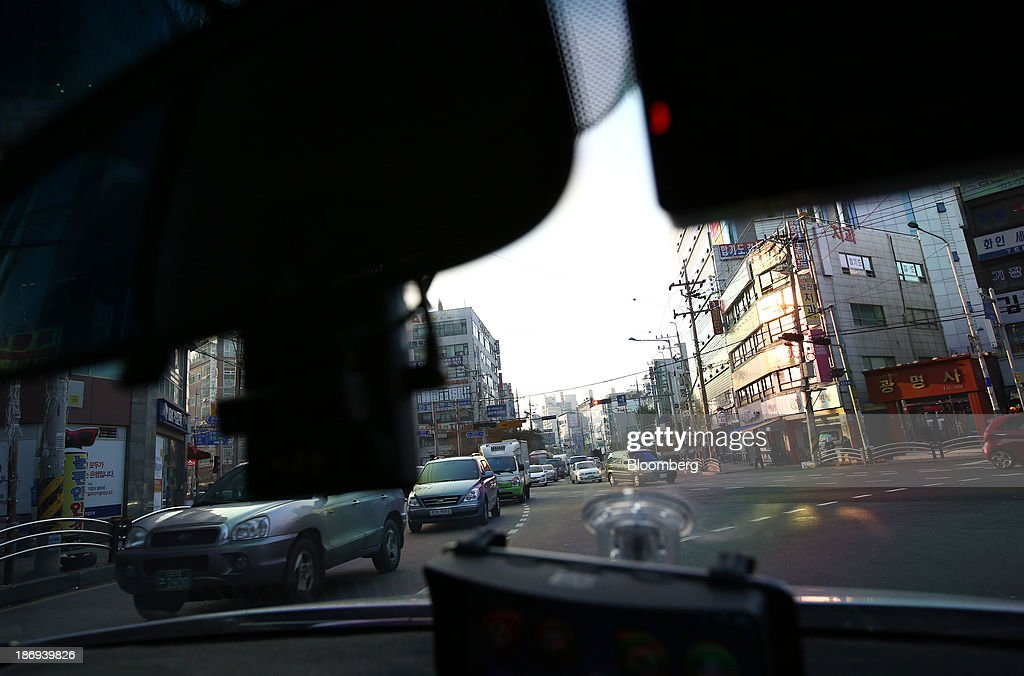 A Joutec Teye black box camera operates inside a vehicle in Incheon, South Korea, on Monday, Nov. 4, 2013. Black boxes for cars are devices that automatically record video and audio as well as time, location and speed. Photographer: SeongJoon Cho/Bloomberg via Getty Images