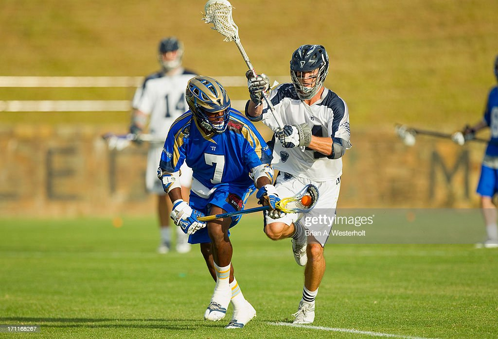 Jovan Miller #7 of the Charlotte Hounds controls a ground ball in front of Dan Burns #4 of the Chesapeake Bayhawks at American Legion Memorial Stadium on June 22, 2013 in Charlotte, North Carolina. The Hounds defeated the Bayhawks 16-15 in overtime.