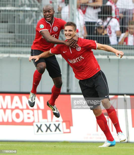 Jovan Vidovic celebrates his team's second goal with Jose Pierre Vunguidica of Wiesbaden during the Third Bundesliga match between SV Wehen Wiesbaden...