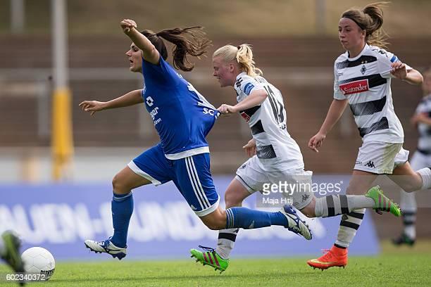 Jovana Damnjanovic of SC Sand is challenged by Jule Dallmann of VfL Borussia Moenchengladbach during the match of Allianz Frauen Bundesliga on...