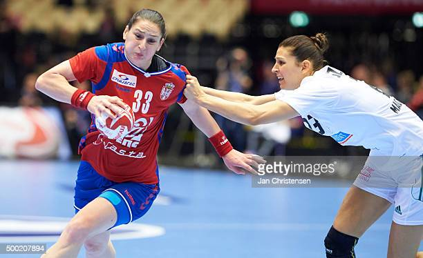 Jovana Stoiljkovic of Serbia challenge for the ball during the 22nd IHF Women's Handball World Championship match between Japan and Montenegro in...