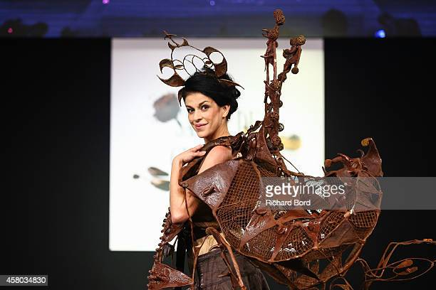 Jovanka Sopalovic walks the runway and wears a chocolate dress made by stylist Stephane Martello and chocolate maker JeanClaude Jeanson during the...