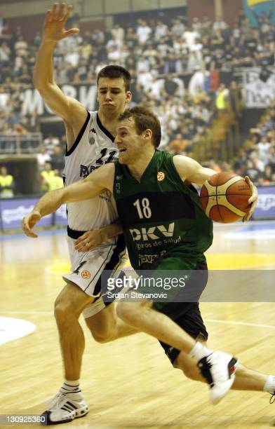 Joventut Badalona player Ferran Lavina right is challanged by Uros Tripkovic left from Partizan Belgrade during the TOP 16 group E Euroleague...