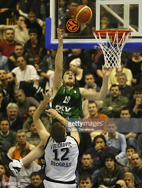 Joventut player Flis Dmitria above scores over Partizan basketball player Novica Velickovic from Partizan during a group B Euroleague basketball...