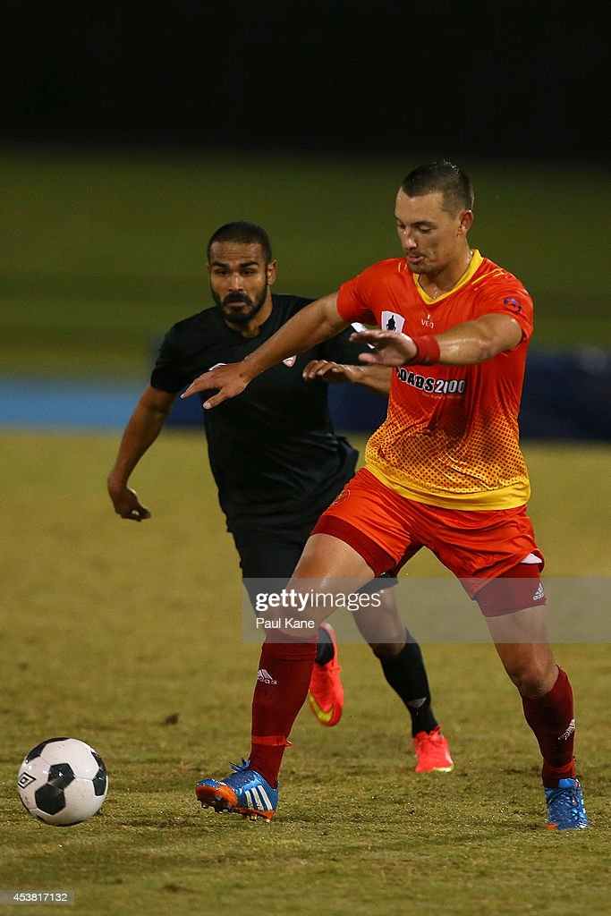 Jovo Pavlovic of the Lions controls the ball against Jean Carlos Salorzano of the Roar during the FFA Cup match between the Stirling Lions and the Brisbane Roar at Western Australia Athletics Stadium on August 19, 2014 in Perth, Australia.