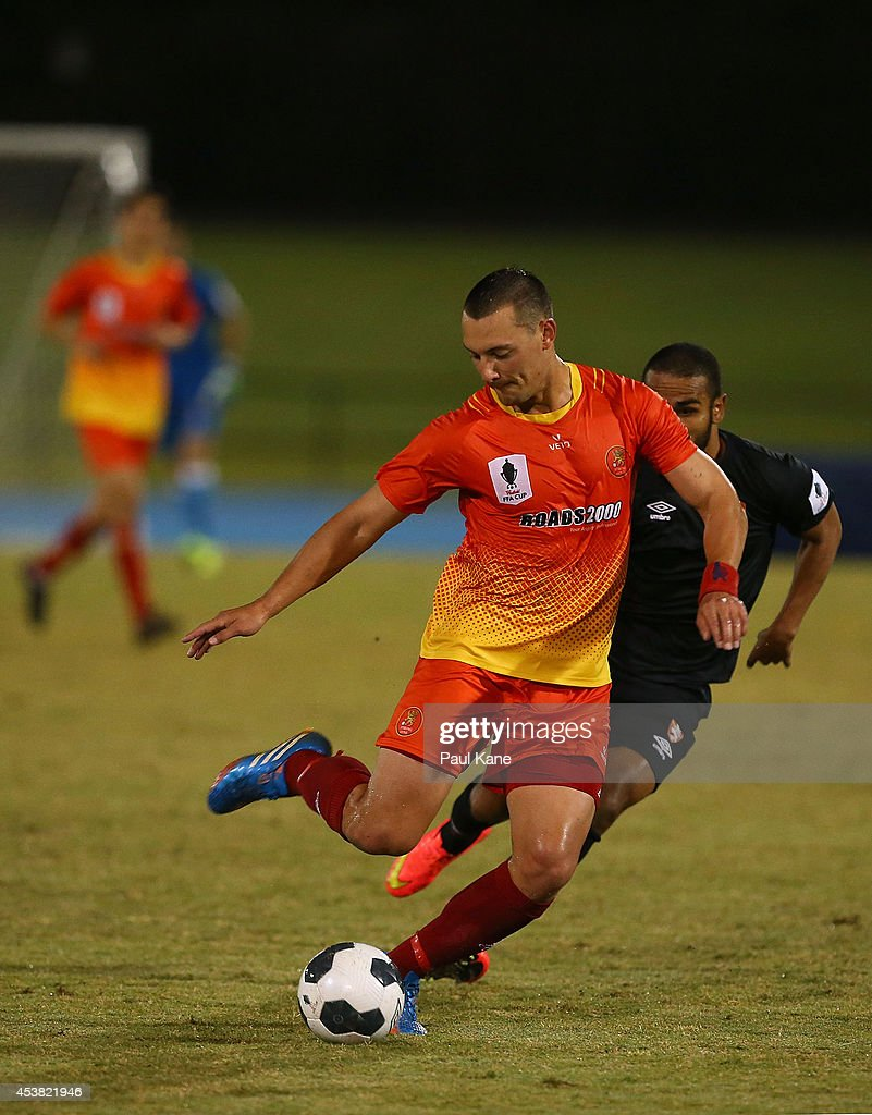 Jovo Pavlovic of the Lions takes a shot on goal during the FFA Cup match between the Stirling Lions and the Brisbane Roar at Western Australia Athletics Stadium on August 19, 2014 in Perth, Australia.