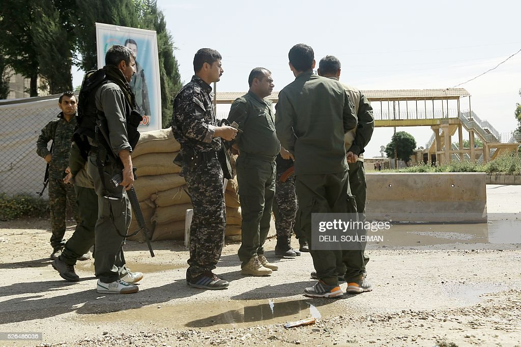 Jowan Ibrahim (C), the commander of the Kurdish police known as the Asayish arrives at a checkpoint where a suicide bomber killed five Kurdish policemen on April 30, 2016 in Syria's divided northeastern city of Qamishli. Four others were wounded in the attack on the city's demarcation line, according to Jowan Ibrahim. It was not immediately clear who carried out the attack, but the Islamic State (IS) group has claimed previous bombings in the mainly Kurdish city. SOULEIMAN