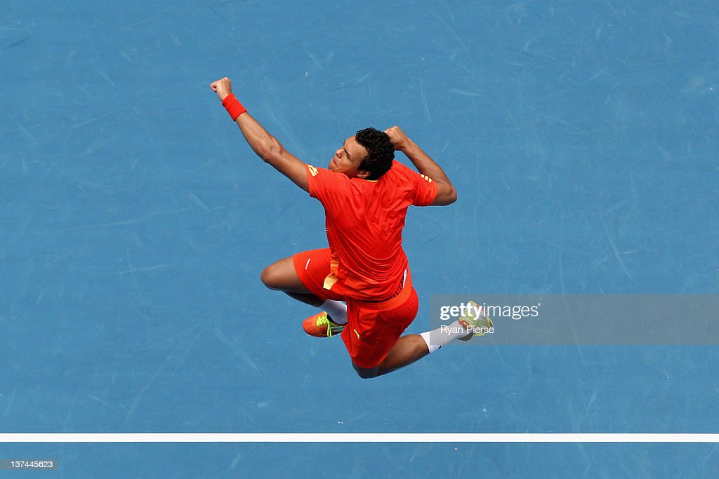 Jo-Wilfred Tsonga of France celebrates winning his third round match against Frederico Gil of Portugal during day six of the 2012 Australian Open at Melbourne Park on January 21, 2012 in Melbourne, Australia.