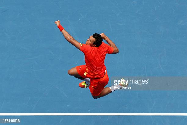 JoWilfred Tsonga of France celebrates winning his third round match against Frederico Gil of Portugal during day six of the 2012 Australian Open at...