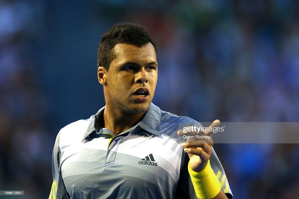 Jo-Wilfred Tsonga of France points for the towel in his Quarterfinal match against Roger Federer of Switzerland during day ten of the 2013 Australian Open at Melbourne Park on January 23, 2013 in Melbourne, Australia.