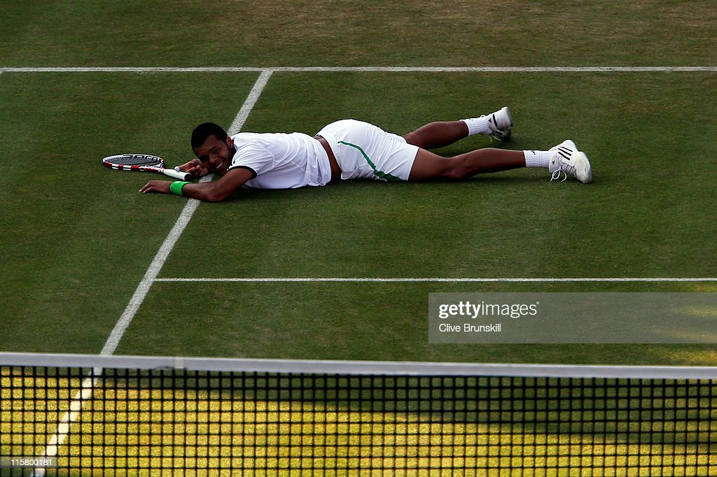 Jo-Wilfred Tsonga of France reacts to a play during his Men's Singles quarter final match against Rafael Nadal of Spain on day five of the AEGON Championships at Queens Club on June 10, 2011 in London, England.