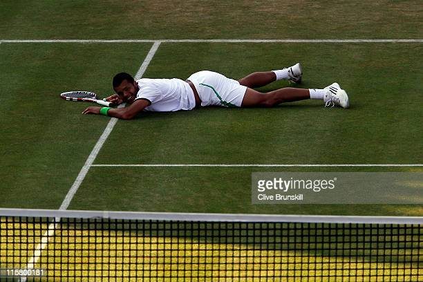 JoWilfred Tsonga of France reacts to a play during his Men's Singles quarter final match against Rafael Nadal of Spain on day five of the AEGON...