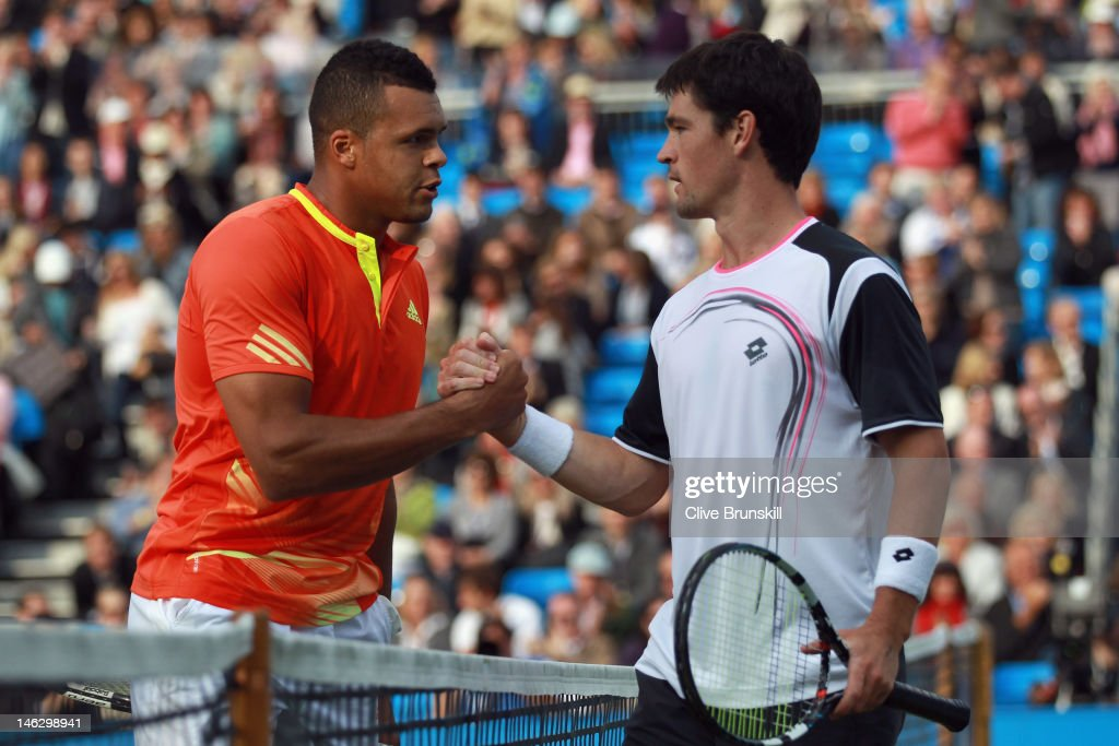 Jo-Wilfred Tsonga of France (L) shakes hands with <a gi-track='captionPersonalityLinkClicked' href=/galleries/search?phrase=Jamie+Baker&family=editorial&specificpeople=583109 ng-click='$event.stopPropagation()'>Jamie Baker</a> of Great Britain after his mens singles second round match on day three of the AEGON Championships at Queens Club on June 13, 2012 in London, England.
