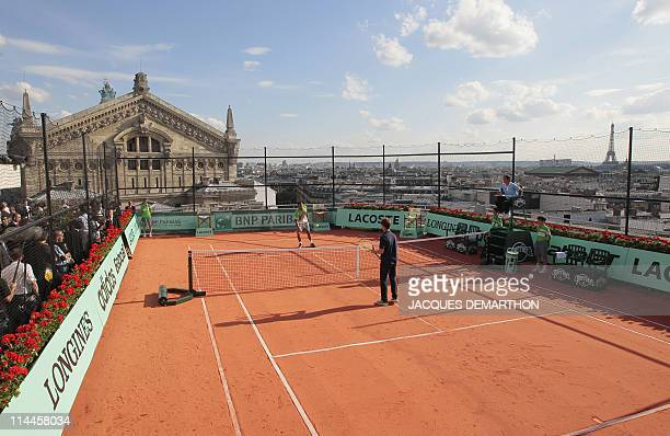 JoWilfrid Tsonga of France and Richard Gasquet of France play an exhibition match on May 19 2011 on the roof of the Galeries Lafayette department...