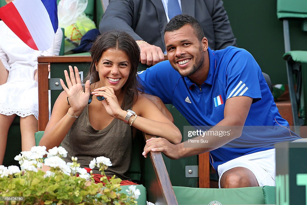 Jo-Wilfried Tsonga and his girlfriend Noura El Shwekh attend the Davis Cup - Semi-final France vs Czech Republic at Roland Garros on September 14, 2014 in Paris, France.