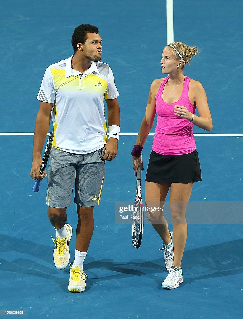 <a gi-track='captionPersonalityLinkClicked' href=/galleries/search?phrase=Jo-Wilfried+Tsonga&family=editorial&specificpeople=553803 ng-click='$event.stopPropagation()'>Jo-Wilfried Tsonga</a> and <a gi-track='captionPersonalityLinkClicked' href=/galleries/search?phrase=Mathilde+Johansson&family=editorial&specificpeople=599541 ng-click='$event.stopPropagation()'>Mathilde Johansson</a> of France talk tactics in their mixed doubles match against Fernando Verdasco and Anabel Medina Garrigues of Spain during day two of the Hopman Cup at Perth Arena on December 30, 2012 in Perth, Australia.