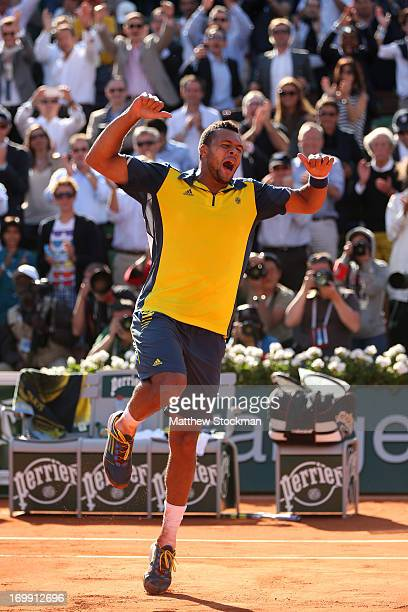 JoWilfried Tsonga of celebrates after victory in his Men's Singles quarter final match against Roger Federer of Switzerland during day ten of the...