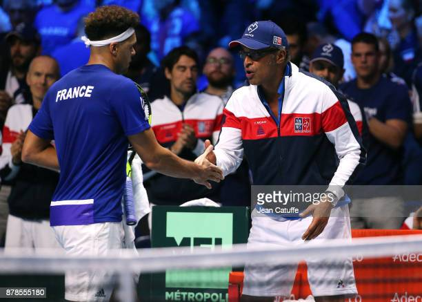 JoWilfried Tsonga of France and Captain of France Yannick Noah during day 1 of the Davis Cup World Group Final between France and Belgium at Stade...