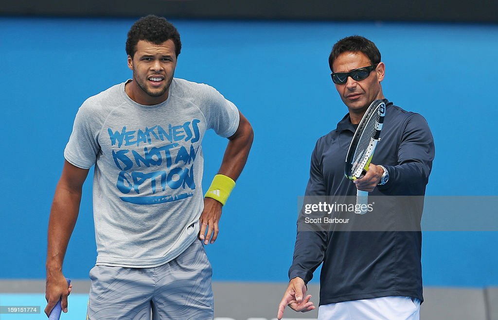 <a gi-track='captionPersonalityLinkClicked' href=/galleries/search?phrase=Jo-Wilfried+Tsonga&family=editorial&specificpeople=553803 ng-click='$event.stopPropagation()'>Jo-Wilfried Tsonga</a> of France and his coach Roger Rasheed look on during a practice session ahead of the 2013 Australian Open at Melbourne Park on January 9, 2013 in Melbourne, Australia.
