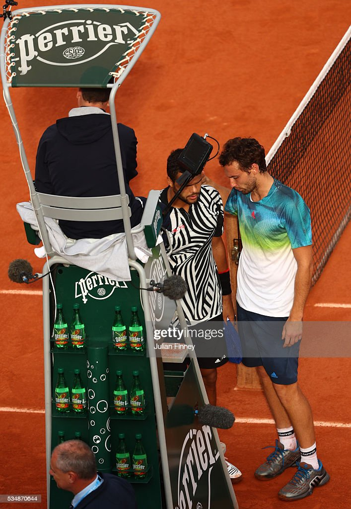 <a gi-track='captionPersonalityLinkClicked' href=/galleries/search?phrase=Jo-Wilfried+Tsonga&family=editorial&specificpeople=553803 ng-click='$event.stopPropagation()'>Jo-Wilfried Tsonga</a> of France announces to <a gi-track='captionPersonalityLinkClicked' href=/galleries/search?phrase=Ernests+Gulbis&family=editorial&specificpeople=4095282 ng-click='$event.stopPropagation()'>Ernests Gulbis</a> of Latvia and the Umpire that he is retiring from the match due to injury during the Men's Singles third round match on day seven of the 2016 French Open at Roland Garros on May 28, 2016 in Paris, France.