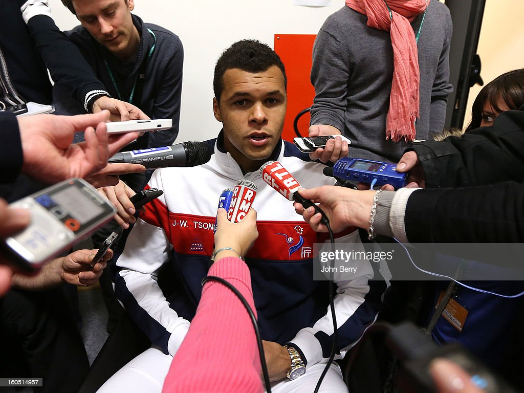 <a gi-track='captionPersonalityLinkClicked' href=/galleries/search?phrase=Jo-Wilfried+Tsonga&family=editorial&specificpeople=553803 ng-click='$event.stopPropagation()'>Jo-Wilfried Tsonga</a> of France answers questions from the press on day one of the Davis Cup first round match between France and Israel at the Kindarena stadium on February 1, 2013 in Rouen, France.