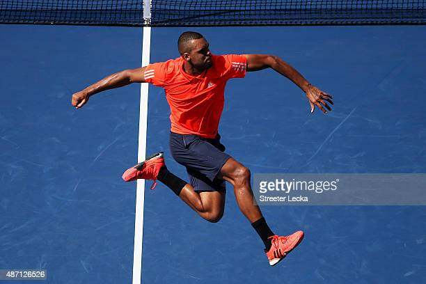 JoWilfried Tsonga of France celebrates after defeating Benoit Paire of France during their Men's Singles Fourth Round match on Day Seven of the 2015...
