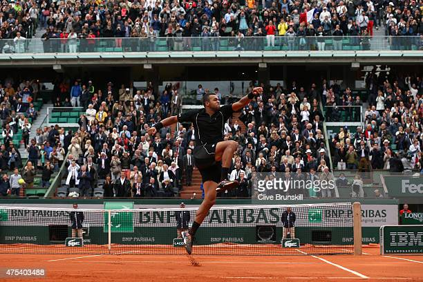 JoWilfried Tsonga of France celebrates after victory in his Men's Singles match against Tomas Berdych of Czech Republic on day eight of the 2015...