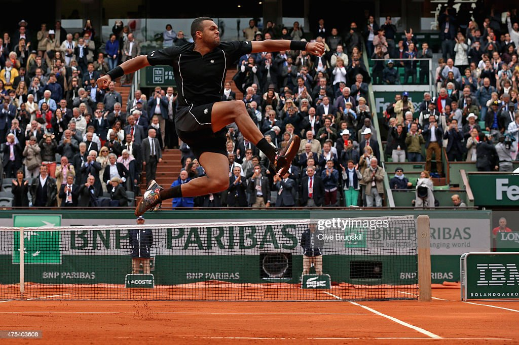 Jo-Wilfried Tsonga of France celebrates after victory in his Men's Singles match against Tomas Berdych of Czech Republic on day eight of the 2015 French Open at Roland Garros on May 31, 2015 in Paris, France.