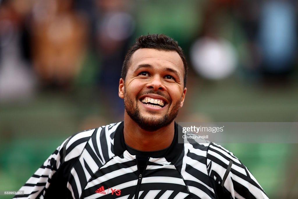 <a gi-track='captionPersonalityLinkClicked' href=/galleries/search?phrase=Jo-Wilfried+Tsonga&family=editorial&specificpeople=553803 ng-click='$event.stopPropagation()'>Jo-Wilfried Tsonga</a> of France celebrates following his victory during the Men's Singles first round match against Jan-Lennard Struff of Germany on day three of the 2016 French Open at Roland Garros on May 24, 2016 in Paris, France.