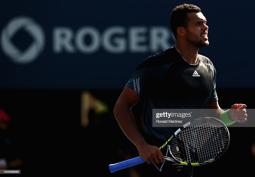 <a gi-track='captionPersonalityLinkClicked' href=/galleries/search?phrase=Jo-Wilfried+Tsonga&family=editorial&specificpeople=553803 ng-click='$event.stopPropagation()'>Jo-Wilfried Tsonga</a> of France celebrates his semifinals win against Grigor Dimitrov of Bulgaria during Rogers Cup at Rexall Centre at York University on August 9, 2014 in Toronto, Canada.