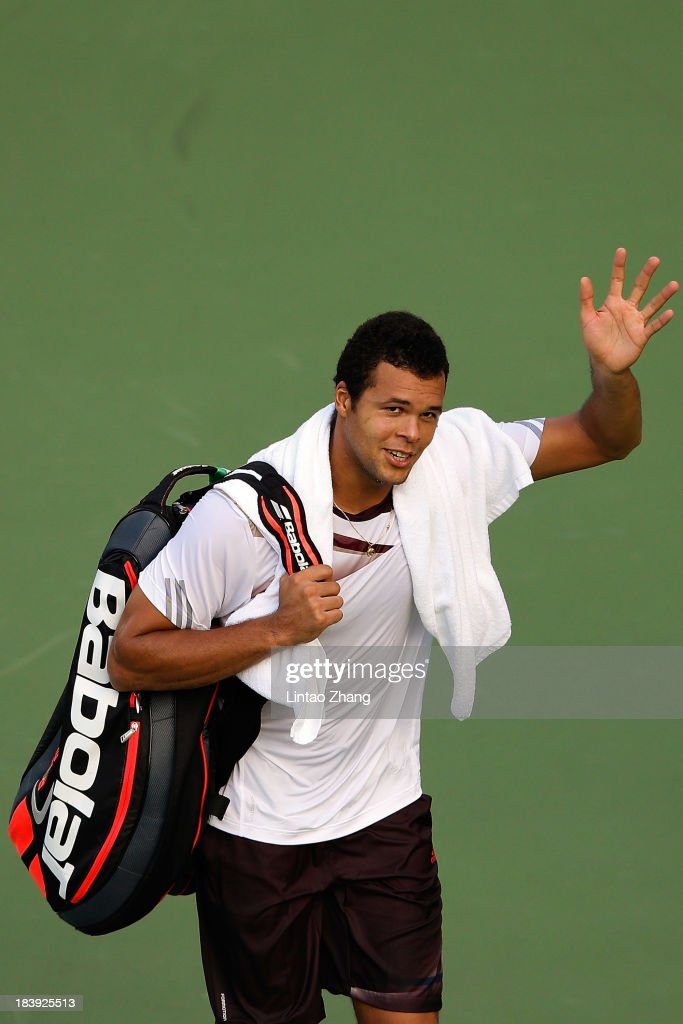 <a gi-track='captionPersonalityLinkClicked' href=/galleries/search?phrase=Jo-Wilfried+Tsonga&family=editorial&specificpeople=553803 ng-click='$event.stopPropagation()'>Jo-Wilfried Tsonga</a> of France celebrates his win against Kei Nishikori of Japan during day four of the Shanghai Rolex Masters at the Qi Zhong Tennis Center on October 10, 2013 in Shanghai, China.