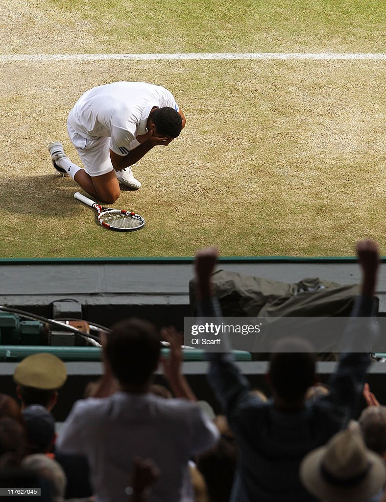 Jo-Wilfried Tsonga of France celebrates match point after winning his quarterfinal round match against Roger Federer of Switzerland on Day Nine of the Wimbledon Lawn Tennis Championships at the All England Lawn Tennis and Croquet Club on June 29, 2011 in London, England.