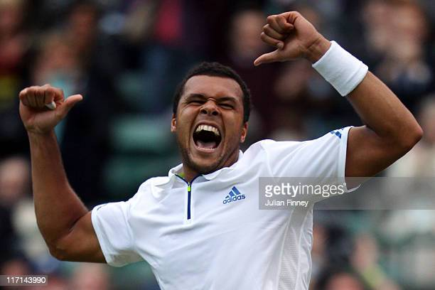 JoWilfried Tsonga of France celebrates match point during his second round match against Grigor Dimitrov of Bulgaria on Day Four of the Wimbledon...