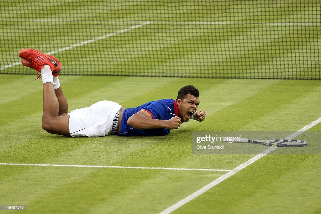 Jo-Wilfried Tsonga of France celebrates match point during the Men's Singles Tennis match against Thomaz Bellucci of Brazil on Day 2 of the London 2012 Olympic Games at the All England Lawn Tennis and Croquet Club in Wimbledon on July 29, 2012 in London, England.
