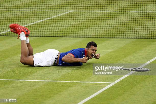 JoWilfried Tsonga of France celebrates match point during the Men's Singles Tennis match against Thomaz Bellucci of Brazil on Day 2 of the London...