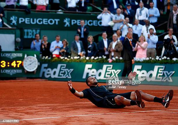 JoWilfried Tsonga of France celebrates match point in his Men's quarter final match against Kei Nishikori of Japan on day of the 2015 French Open at...